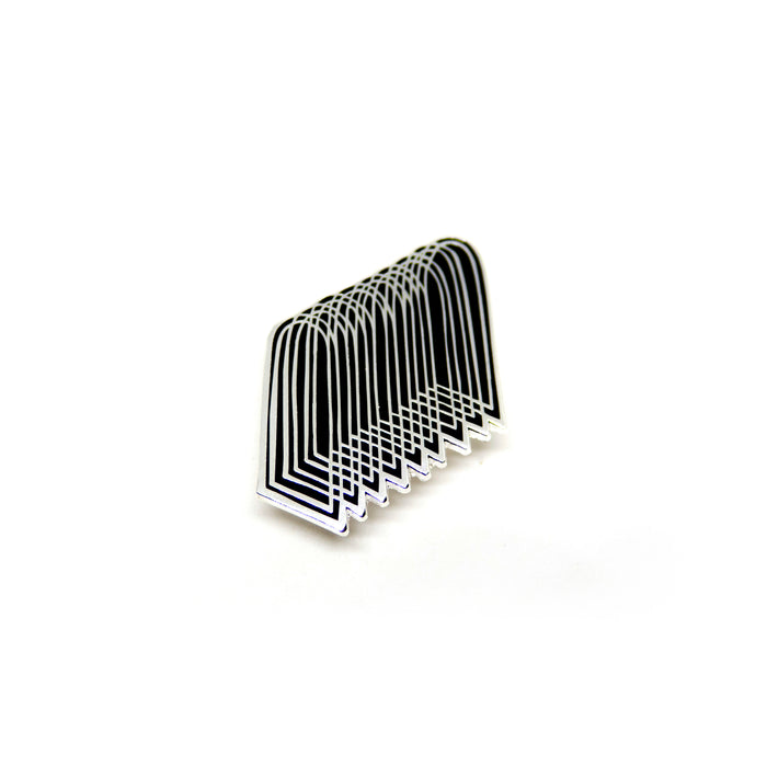 hard enamel pin of overlapping arches, silver colored intricate outlines on black