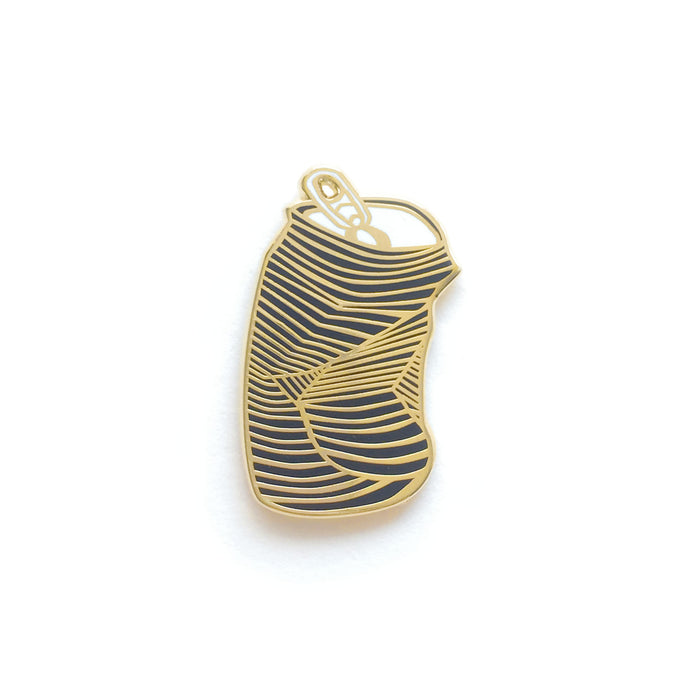 a hard enamel pin, dented beverage can with gold outlines on black with white top and tab