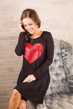Seated View of Valentines Day Dress Black Long Sleeve Swing Dress With Red Sequin Heart