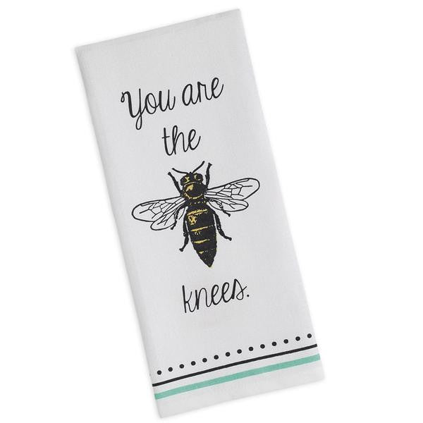 white dish towel with mint and black stripe and dot accent on bottom with you are the bees knees in center of towel. picture of bee in the middle in place of the word bee