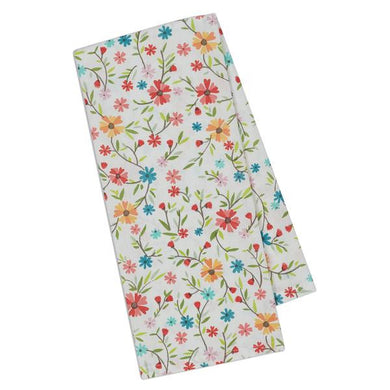 ivory colored dishtowel with multi-colored flowers daisies covering the towel from front to back
