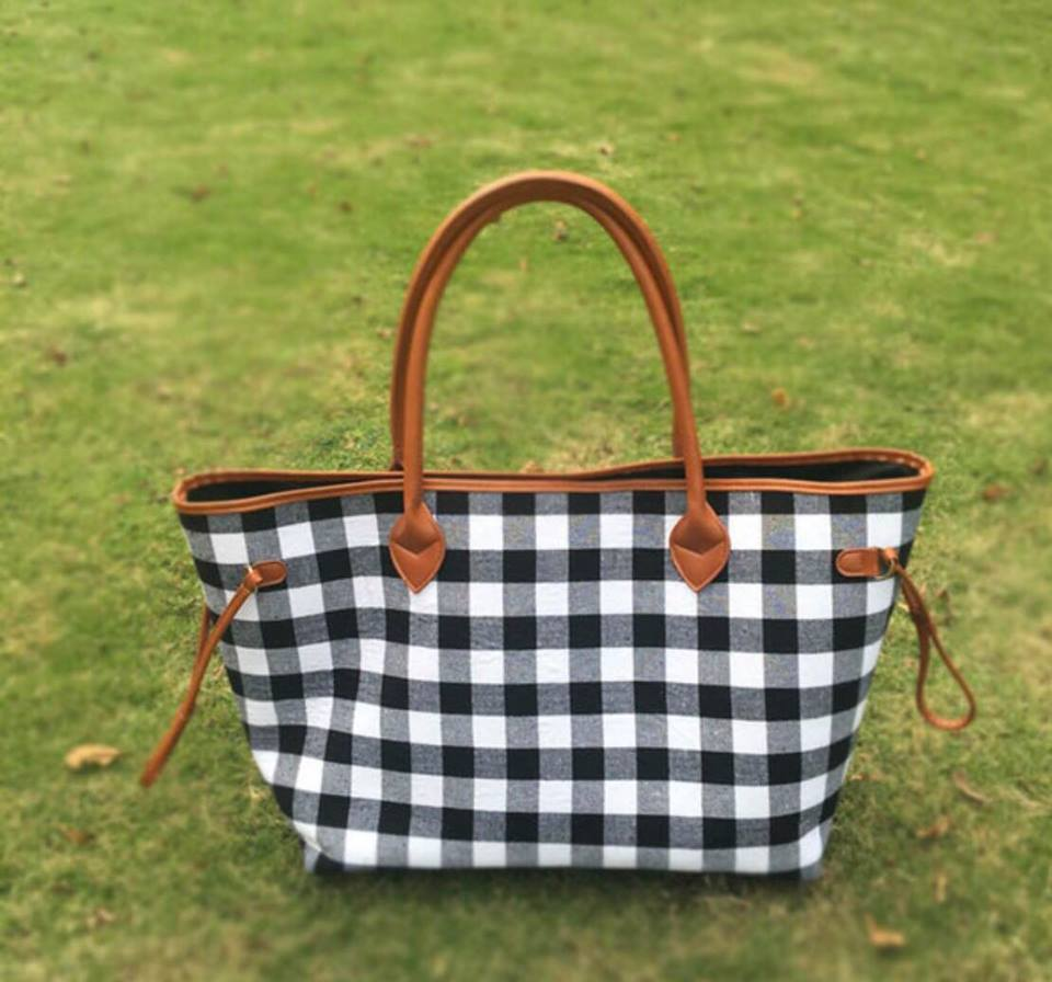 large black and white buffalo check plaid bag with brown straps. perfect for anytime of the year and super eye catching