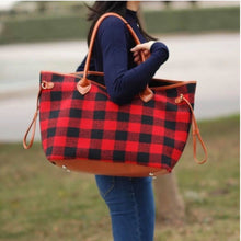 large black and red buffalo check plaid bag with brown straps. perfect for anytime of the year and super eye catching