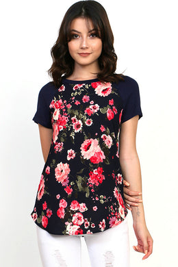floral short sleeve top with black background contrast with rounded neck and bottom