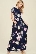 Navy and floral print short sleeve long maxi with soft and stretchy material, scoopneck, and pockets