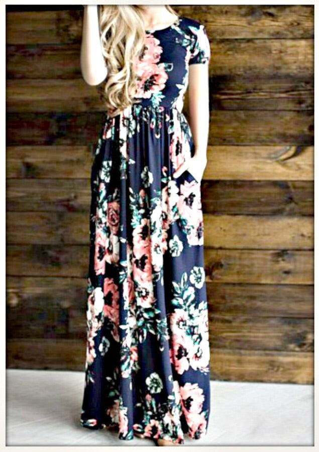 Navy and coral floral print short sleeve long maxi dress with soft and stretchy material, scoopneck, and pockets