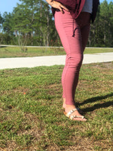 side view of raspberry moto jeggings with real back pockets and an elastic waistband. can be worn everyday casual or with a dressy top and heels. S/M fit- 2-6. M/L fit- 8-10