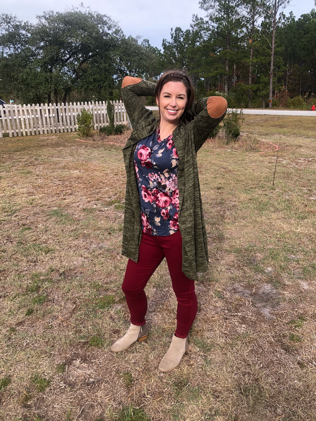 Long sleeve, past the knee in length, olive army green heathered look cardigan with faux brown suede elbow patches. Soft and cozy perfect for layering