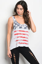 cream colored tank top with american flag distressed look and faded red, white, and blue design. racer back and flowing hem