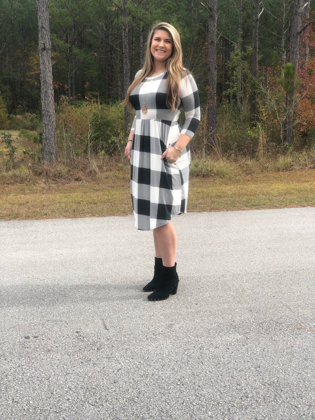 3/4 quarter sleeve past the knee midi black and white buffalo check plaid cinched and the small of your waist with pockets