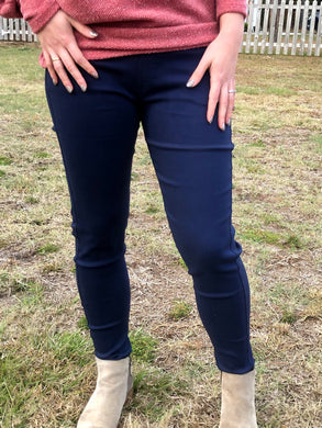 Navy 5 pocket jeggings with an elastic waistband. super stretchy and super comfortable. perfect for a casual everyday look or with a dress shirt and heels. S/M fit- 2-6 M/L fit- 8-10