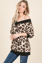 leopard print sweater with thick black trim. V neck and V back with a slouchy and off the shoulder or regular neck.