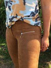 up close view of zipper accent on camel faux suede jeggings with real back pockets and adorable silver zipper accent on front pocket area. jeggings have an elastic waistband and are so soft and comfortable