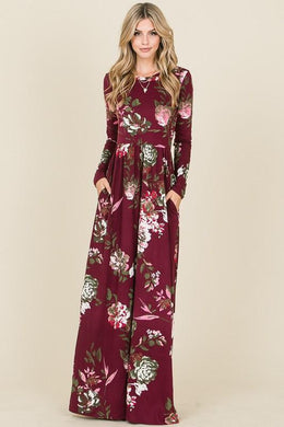 long sleeve burgundy and floral long mazi dress. super soft and stretchy material cinched at the small of your waist. beautiful eye catching burgundy color. and has pockets