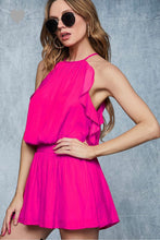 silky feel spaghetti strap fushia pink romper with smocked waist. frills lining side and back with keyhole back