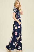 side view of Navy and floral print short sleeve long maxi with soft and stretchy material, scoopneck, and pockets