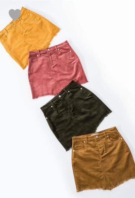mustard, blush, olive green, and camel colored corduroy mini skirt with a zipper fly. equipped with belt loops and pockets. frayed hem on the bottom