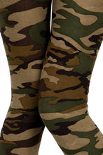 "up close view of full- length one size- Women's 0-14 and plus size- women's 14-20 mix print camo leggings are so soft, stretchy, lightweight, and have a 1"" inch waistband. smooth fabric, 92% Nylon 8% spandex"
