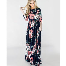 Navy and coral floral print 3/4 long sleeve long maxi dress with soft and stretchy material, scoopneck, and pockets