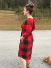 side view of 3/4 quarter sleeve past the knee midi black and red buffalo check plaid cinched and the small of your waist with pockets