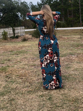back view of Navy and floral print 3/4 long sleeve long maxi dress with stretchy, soft, and comfortable material with pockets. perfect for any occasion and so many seasons