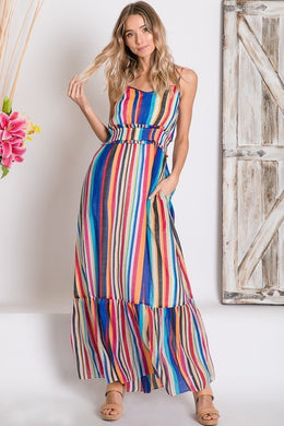 mulit-color stripe serape maxi with adjustable spaghetti strapes, smocked waist, and ruffle hem