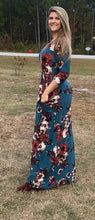 side view of Navy and floral print 3/4 long sleeve long maxi dress with stretchy, soft, and comfortable material with pockets. perfect for any occasion and so many seasons