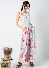 pale mint and floral print pattern long maxi dress with sleeveless top. cinched at small of wasit and has pockets