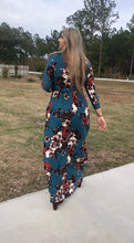 walking back view of Navy and floral print 3/4 long sleeve long maxi dress with stretchy, soft, and comfortable material with pockets. perfect for any occasion and so many seasons