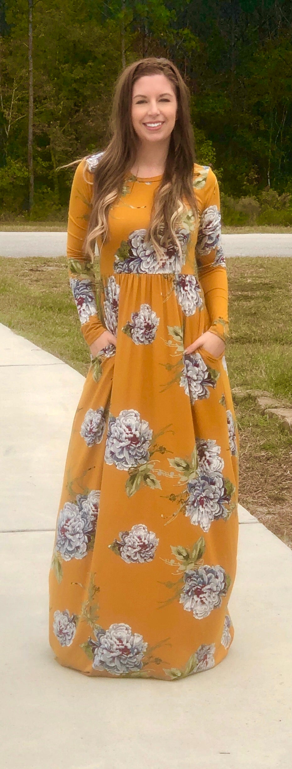 mustard and floral print long sleeve long maxi dress. soft and stretchy material. cinched at the waist with pockets