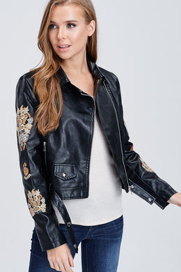 faux leather jacket with embroidered sleeves. meets at your waist. zip up in front and tie around waist