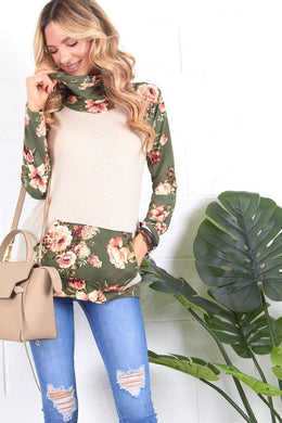 cream and olive floral sweater top. Long sleeve with olive floral contrast from burgundy flows to draw string gathered neck line and front pouch