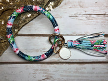 pink, magenta, green, blue tropical flamingo bangle ring keychair with tassle and monogram tag. large ring for any size wrist and easy clip for attaching keys. contains two 2 rings to attach keys to. tropical, flamingo, cute, and fun.