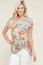 greyish lavender shortsleeve top with floral print and a twist hem at the bottom