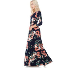 side view of Navy and coral floral print 3/4 long sleeve long maxi dress with soft and stretchy material, scoopneck, and pockets