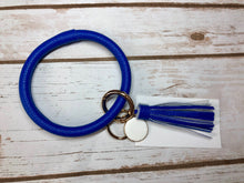 blue royal blue bangle ring keychair with tassle and monogram tag. large ring for any size wrist and easy clip for attaching keys. contains two 2 rings to attach keys to. monochromatic, cute, and fun.