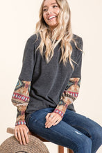 charcoal grey gray long sleeve sweater top with aztec print on sleeves.