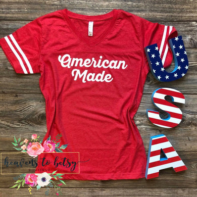 red short sleeve tee with 2 two white strips on sleeves and says american made center in white lettering