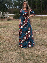 Navy and floral print 3/4 long sleeve long maxi dress with stretchy, soft, and comfortable material with pockets. perfect for any occasion and so many seasons