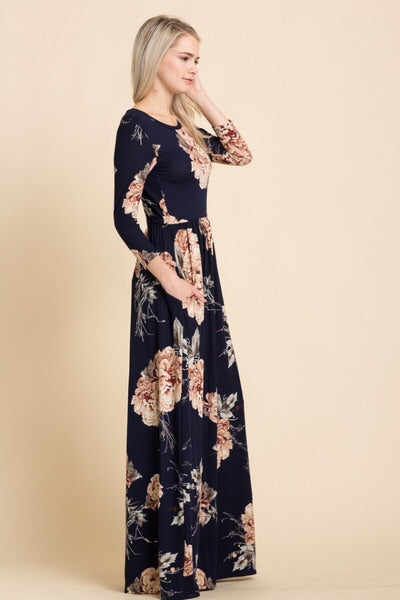 side view of navy and blush floral print long sleeve long maxi dress with cinched waist and pockets
