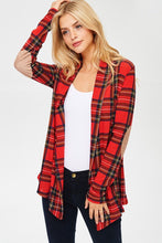 red plaid open face cardigan with long sleeves and faux suede light brown elbow patches. passed the butt in length