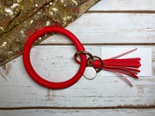 red vibrant red bangle ring keychair with tassle and monogram tag. large ring for any size wrist and easy clip for attaching keys. contains two 2 rings to attach keys to. monochromatic, cute, and fun.