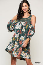 Forrest green floral with a crochet neckline. Cold shoulder with a 3/4 sleeve. Flowy and boho