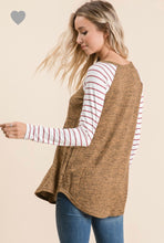 back view of long sleeve camel rust solid body with mauve and white striped long sleeves. round neck line and hem