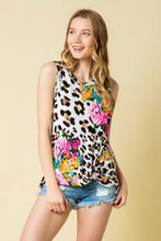 sleeveless floral and leopard mix print with a twist hem. perfect for summer and fall and cute with shorts or jeggings and sandals or booties.