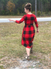 back view of 3/4 quarter sleeve past the knee midi black and red buffalo check plaid cinched and the small of your waist with pockets
