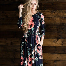 zoomed in view of Navy and coral floral print 3/4 long sleeve long maxi dress with soft and stretchy material, scoopneck, and pockets