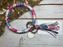 Pink, fuchsia, magenta, and blue tropical bangle ring keychair with tassle and monogram tag. large ring for any size wrist and easy clip for attaching keys. contains two 2 rings to attach keys to. tropical, cute, and fun.
