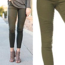 olive green moto jeggings with real back pockets and an elastic waistband. can be worn everyday casual or with a dressy top and heels. S/M fit- 2-6. M/L fit- 8-10