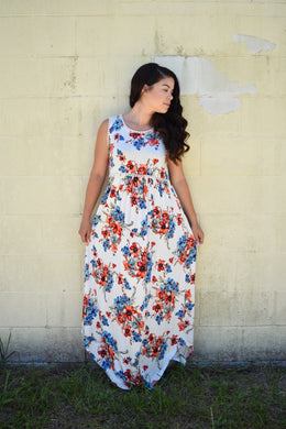 sleeveless ivory floral maxi with ivory waist and neck. light and flowy dress perfect for the summer. paired perfectly with your favorite wedges
